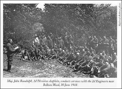 Maj. John Randolph, 2d Division chaplain, conducts             services with the 2d Engineers near Belleau Wood, 30 June 1918.