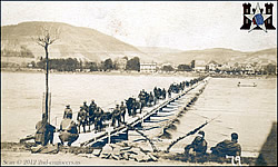 Pontoon bridge complete at Honningen with the light Artillery crossing over.